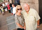 """Joan and Rick Kerlin of Upper St. Clair wait in line to attend the private screening of """"The Dark Knight Rises"""" July 17, 2012, at the Byham Theater. Rick is the manager of the Primanti Brothers restaurant located Downtown on Cherry Way, where the Batmobile was blown up for a scene."""