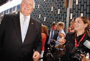 """Gov. Tom Corbett makes his way past reporters and photographers as he heads into the private screening of """"The Dark Knight Rises"""" July 17, 2012 at the Byham Theater."""