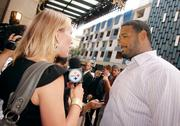 """Pittsburgh Steelers tackle Max Starks chats with a reporter from Steelers.com as Starks heads into the private screening of """"The Dark Knight Rises"""" on July 17, 2012, at the Byham Theater."""