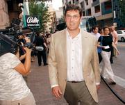 """Bob Nutting, principal owner of the Pittsburgh Pirates, heads into the private screening of """"The Dark Knight Rises"""" on July 17, 2012, at the Byham Theater in downtown Pittsburgh."""