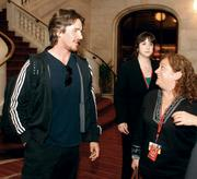 """The Dark Knight Rises"" star Christian Bale chats with unit publicist Claudia Kalindjian following a news conference in downtown Pittsburgh."