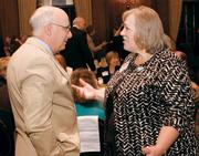 Dennis Unkovic of Meyer, Unkovic & Scott LLP chats with Susan Rademacher of Pittsburgh Parks Conservancy on Aug. 7 at the Pittsburgh Business Times VisionPittsburgh event held at the Duquesne Club in downtown Pittsburgh.