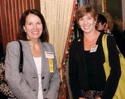 Mary Sleighter, left, of  Sisterson & Co. LLP chats with Marcia Kern of Fifth Third Bank.