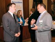 Nathanael Wilson, left, of Pair Networks, Inc. chats with Jason Hanlon of Consolidated Communications.