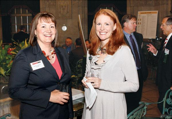 KFMR'S Debbie Lestitian, left, and Absolute Capital Management's Renee Gebben network at the Pittsburgh 100 reception held Aug. 25, 2011 at the Duquesne Club.