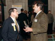 Mitch Barcaskey, left, of First Niagara and Mike Orie of Heartland Restaurant Group, LLC chat at the Pittsburgh 100 reception held August 25, 2011 at the Duquesne Club.