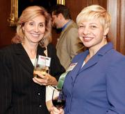 Lisa Valli Steliotes, left, of Luttner Financial Group and Anne Parys of Rothman Gordon, P.C. network at the Pittsburgh 100 reception held Aug. 25, 2011 at the Duquesne Club.