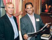 Doug Blasiman, left, and Jason Wolfe of Wolfe.com look over the Pittsburgh 100 supplement to the Pittsburgh Business Times at the Pittsburgh 100 reception held Aug. 25, 2011 at the Duquesne Club. Wolfe is president and CEO of MyCoupons.com, which won an award.