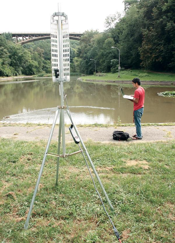 An access point, router and antenna sit on the banks of the Panther Hollow pond as Abhinav Valada of Platypus prepares robotic airboats for a demonstration on Sept. 4, 2012.