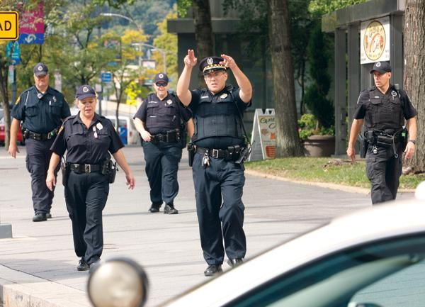 Police move back the media from the Gateway Center complex during Friday's hostage situation, which resolved peacefully before 2 p.m. Friday afternoon.