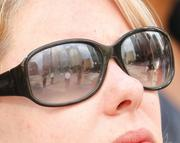 Three Gateway Center, the scene of a hostage situation in downtown Pittsburgh, is reflected in the sunglasses of an interested bystander.