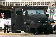 A tactical operations vehicle sits at the ready outside of Three Gateway Center in downtown Pittsburgh, where a hostage situation was taking place.