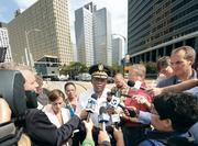 Pittsburgh Police Chief Nate Harper meets with members of the news media near Three Gateway Center in downtown Pittsburgh, where a hostage situation was taking place September 21, 2012.