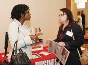 Duquesne University's Sonia Layne-Gartside chats with Elaine Aggazio of Bombardier Transportation.