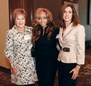 Award winner Caroline O'Connor, center, of Carol Harris Staffing, LLC , was joined by co-workers Carol Harris, left, and Kelly Prucnal