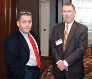 Nick Meddis. left, of Dollar Energy Fund and Jim Escovitz of Dollar Energy Fund's Board of Directors.