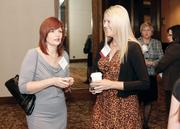 Beth Marcello, left, of PNC Bank, chats with Brandee Abel of TiER 1 Performance Solutions.