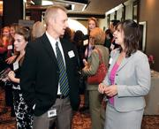 Mark Petrosky of Fed Ex Ground chats with Michelle Naccarati-Chapkis of Women for a Healthy Environment.