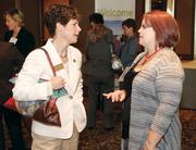 Anne Flynn Schlicht of Chatham University chats with Wendy McCabe of the American Heart Association.