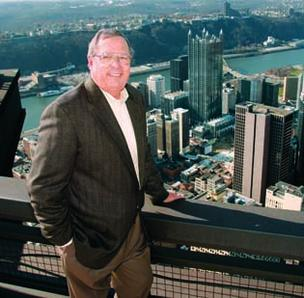 Jack Norris of CBRE stands on the rooftop of the U.S. Steel Tower, downtown. Norris will retire in April.
