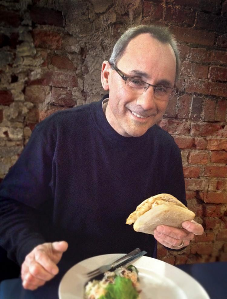 Bill Garrison and an English cod sandwich at Penn Avenue Fish Co. in Downtown Pittsburgh.