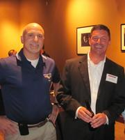 Brian Schill, left, of Wings Over Pittsburgh and John Faigley of Computer Comfort  on Thursday, Aug. 4, at PNC Park in Pittsburgh for the Pittsburgh Business Times' BizMix networking event.