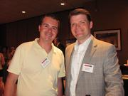 From left: Cliff Davison of Allegheny Valley Bank, and Adam Goetz of A.D. Goetz Financial on Thursday, Aug. 4, at PNC Park in Pittsburgh for the Pittsburgh Business Times' BizMix networking event.