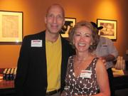 Russ Babines of Prestige Capital Corp. and Lynne Scanga of NIRA Engineering on Thursday, Aug. 4, at PNC Park in Pittsburgh for the Pittsburgh Business Times' BizMix networking event.