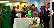 Halloween party Monday at Calgon Carbon Corp. NOTE: The table that the group is gathered around is actually another person in a costume.