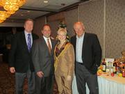 """Catholic Charities hosted its annual holiday """"Be the Blessing"""" at LeMont. From left: Pittsburgh Pirates announcer Greg Brown, Catholic Charities Board President Ed Friel, Executive Director Susan Rauscher and Pirates color commentator Steve Blass."""