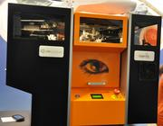 The Mcor Technologies IRIS 3-D printer uses standard, letter-sized printer paper to build photo-realistic physical models.