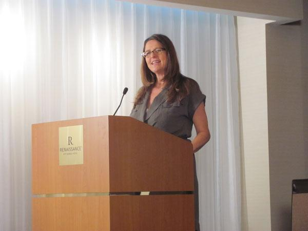 "Dawn Keezer, director of the Pittsburgh Film Office, speaks at a news conference before production begins in July 2011 for ""The Dark Knight Rises."""