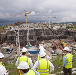 Executives from Eaton Corp. (NYSE: ETN) and GUPC tour the Panama Canal Expansion Project site. Eaton Corporation's power management products and services are being used in the Panama Canal expansion project.