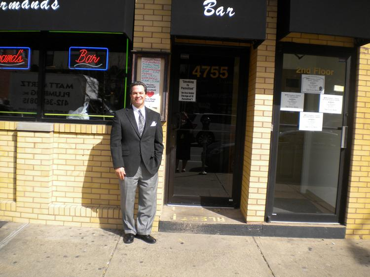 Bob Buzzelli, Fifth Third Private Client Group senior vice president and managing director, in front of Armand's.
