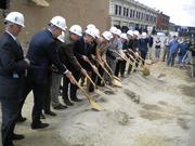 A host of public officials, development partners and community members break ground.
