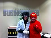 """Pittsburgh Business Times employees Debra Mazzocco, left, dressed up as a """"mad scientist"""" and Sandra Bryson dressed up as Elmo on Monday."""