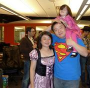 Super IT Manager: Weiyi Yang and his family at M*Modal in Squirrel Hill.