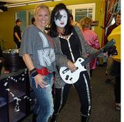 Paul Stanley and groupie, Kelly Read and Debbie Baird, at M*Modal's Halloween party Friday in Squirrel Hill.