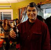President Reagan enjoying a beverage Friday at M*Modal's holiday party at its Squirrel Hill offices.