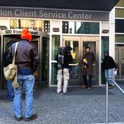 Occupy PIttsburgh protesters stand near the Ross Street entrance of BNY Mellon. The bank locked the doors and would not let anyone enter the building.