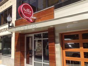 Hello Bistro's exterior, featuring wood-grained garage doors, on Forbes Avenue in the heart of Oakland.