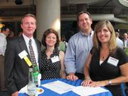 From left: Richard W. James of Spilman Thomas & Battle, Rebecca James of Alpern Rosenthal, Christopher J. Balent of BalenTech Inc. and Jeanne G. Balent at the BizMix hosted Wednesday, June 22, by the Pittsburgh Business Times at the Pittsburgh Zoo & PPG Aquarium.