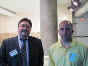 Ronald W. Schuler, left, of Spilman Thomas & Battle in Pittsburgh, and Joe Butera of Long Business Systems in Pittsburgh at the BizMix hosted Wednesday, June 22, by the Pittsburgh Business Times at the Pittsburgh Zoo & PPG Aquarium.