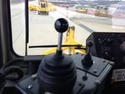 The plows are controlled via joystick, with the smaller one on the left moving the plows in and out. Fully deployed the plows are about 21 feet in width, estimates driver Ernie Gill. Snow plow drivers have to make sure they don't hit the navigation lights that dot the runway and taxiway. The left joystick controls the up and down action of the plow.
