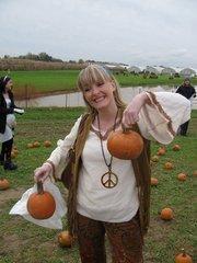 Christina Morgan an employee at Songwhale  at Janoski's Farm picking pumpkins.