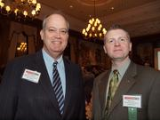 Bill Flanagan of the Allegheny Conference on Community Development, left, and Bill Lucas of Junior Achievement of Western Pennsylvania during the Pittsburgh Business Times' Vision Pittsburgh event Wednesday, March 7, 2012, at the Duquesne Club in Downtown Pittsburgh.