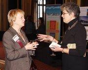 Nancy Bromall of Schneider Downs, left, and Anita Brattina of AllFacilities Energy Group, an award winner.
