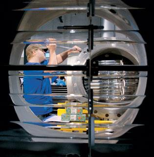 As seen through a 24-inch Sentinal drinking water disinfection reactor at Calgon Carbon Corp.'s UV Technologies Division in Findlay Township, a worker performs mechanical assembly on a drinking water ultraviolet oxidation reactor.