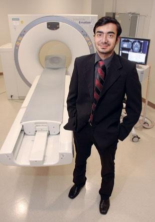 HighField Urgent Care office manager Saurabh Bhatia stands in the CT scan room of HighField Imaging in Green Tree.