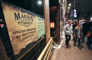 A sign posted outside of Mario's on the 1500 block of East Carson Street on the South Side clearly spells out the fate of fake identification used by underage patrons who attempt to enter the establishment.